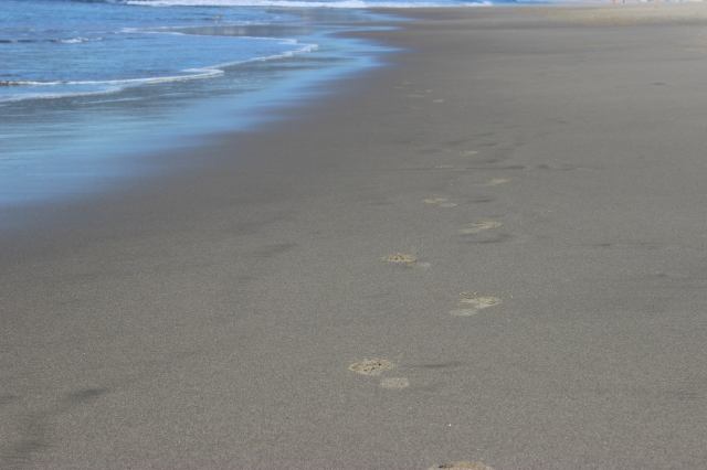 Footsteps near ocean